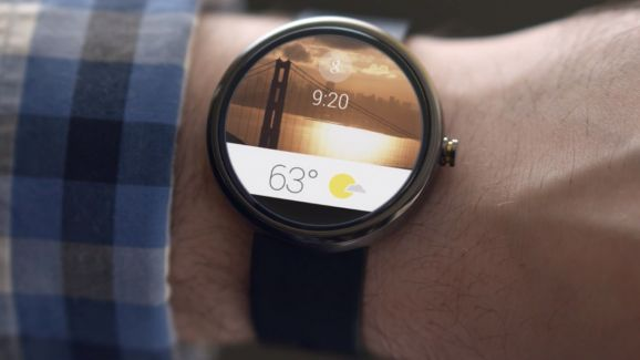 A photo of a Motorola 360 smart watch.